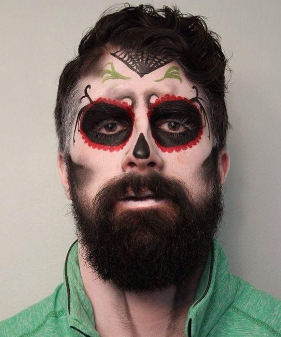 hombre con barba maquillado