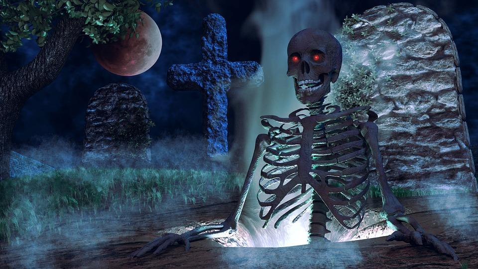 esqueleto saliendo de su tumba